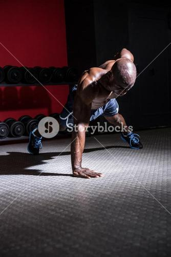 Young Bodybuilder doing One-armed push ups