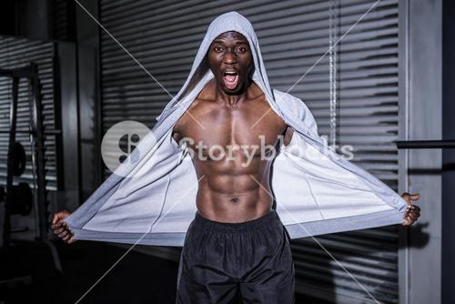 Young Bodybuilder in a hoodie looking at the camera totally surprised