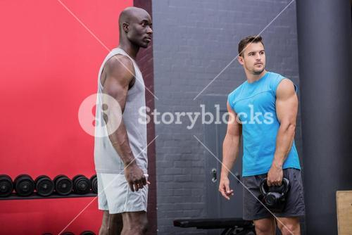 Two young Bodybuilder looking in the distance