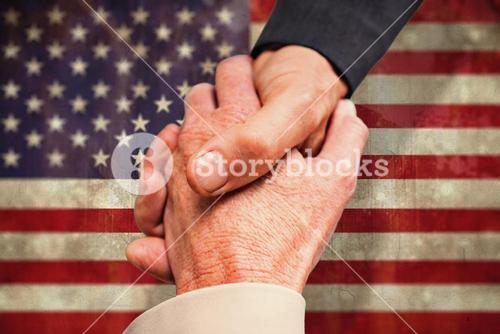 Composite image of close up on business people shaking hands