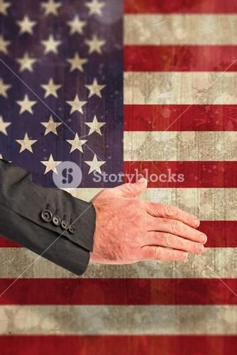 Composite image of businessman reaching hand out