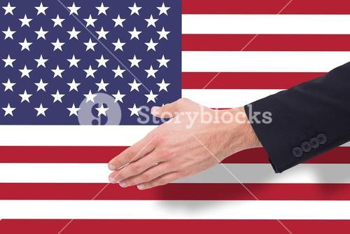 Composite image of close up of businessman offering handshake