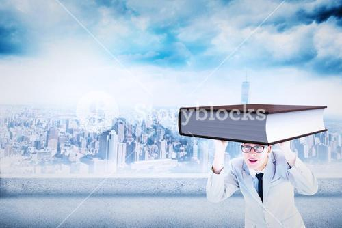 Composite image of businessman peeking
