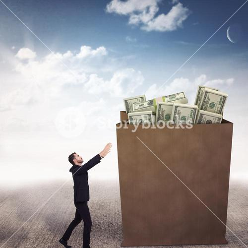 Composite image of businessman with arms raised catching something