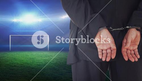 Composite image of businessman in handcuffs