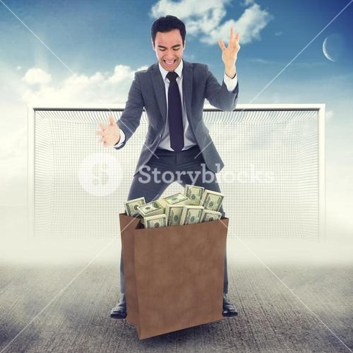Composite image of screaming businessman catching