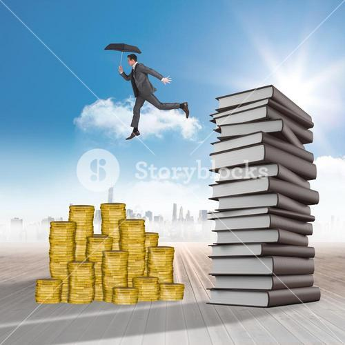 Composite image of businessman jumping holding an umbrella