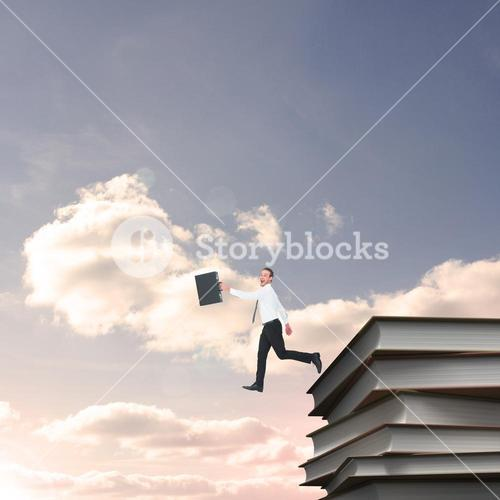 Composite image of happy businessman leaping with his briefcase