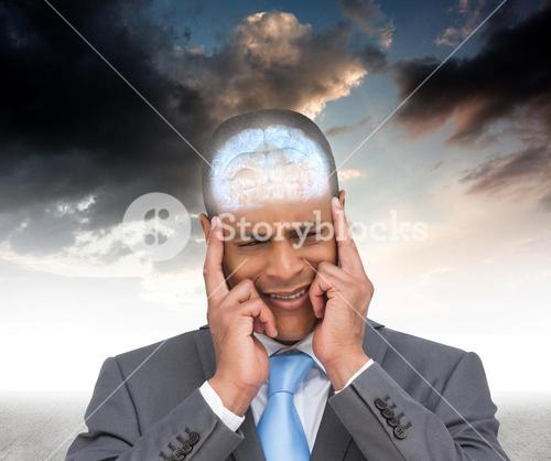 Composite image of stressed businessman putting his fingers on his temples