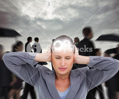 Composite image of close up of annoyed tradeswoman covering her ears