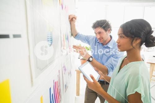 Business team analyzing charts together
