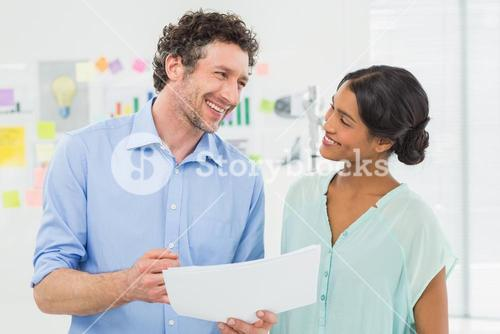 Two creative business people laughing