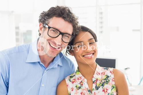 Portrait of a smiling casual young couple at work