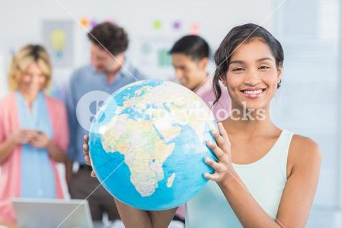 Casual woman holding a globe