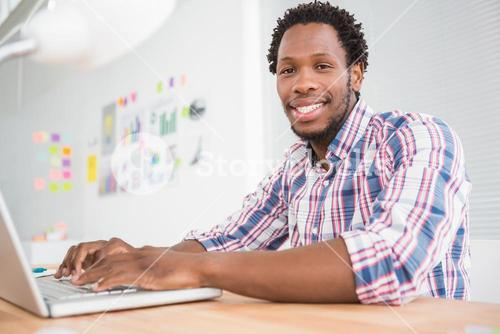 Young businessman types on the laptop