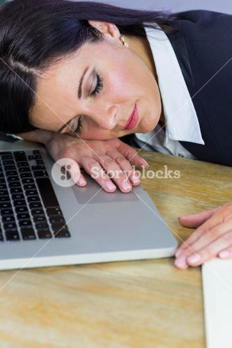 Businesswoman taking a nap on her desk
