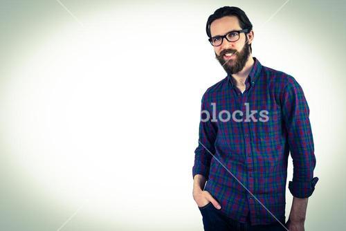Handsome hipster with hand in pocket