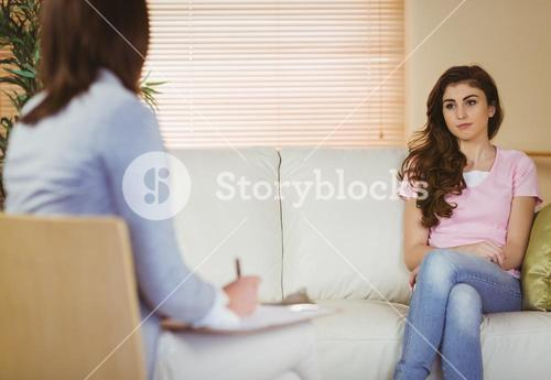Therapist listening to her patient