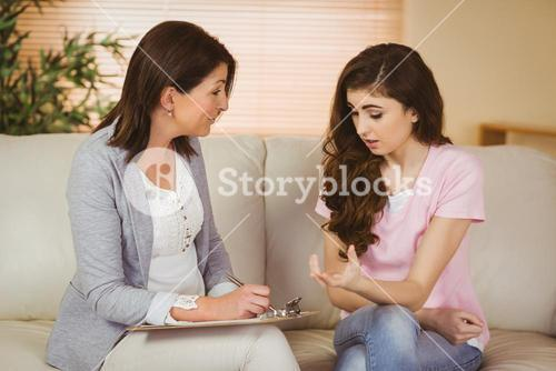 Therapist listening to her upset patient