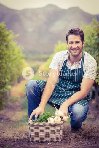 Young happy farmer looking at the camera