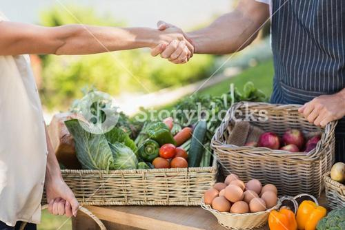 Farmer and customer shaking hands