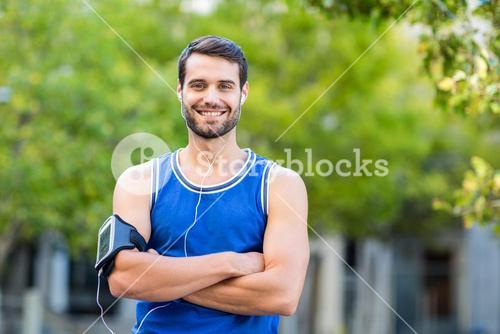 Portrait of an happy handsome athlete
