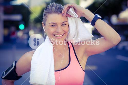 A beautiful athlete resting with a towel