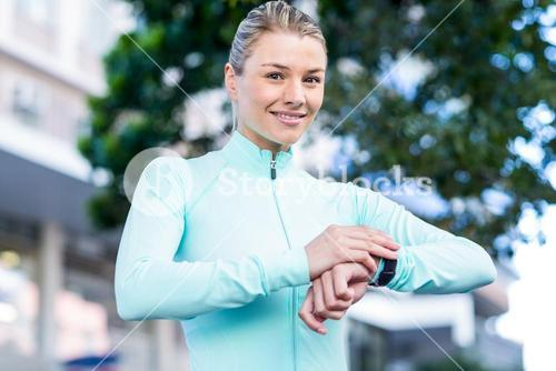 A beautiful athlete watching her watch