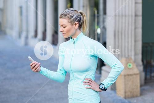 A beautiful athlete using her phone