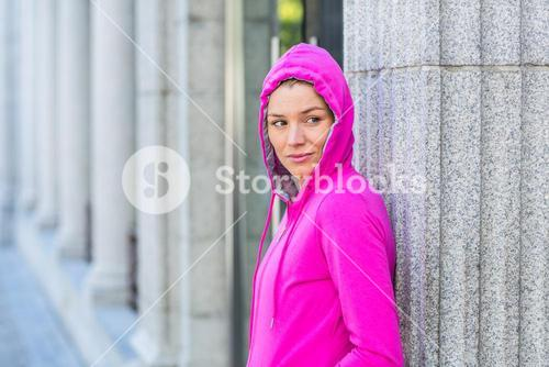 A woman wearing a pink jacket