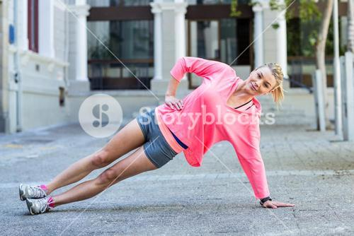 Pretty woman planking on the floor