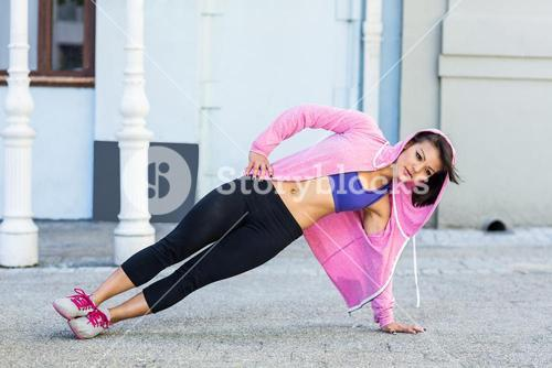 Athletic woman exercising side plank