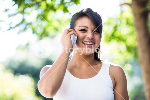 Portrait of smiling athletic woman phoning with smartphone