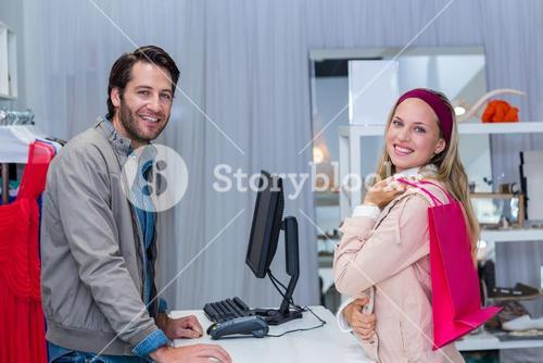 Smiling cashier and his customer