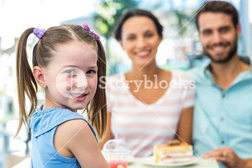 Portrait of a family eating at the restaurant