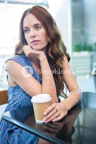 Pretty brunette with a take away cup