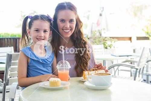 Mother and daughter at cafe terrace