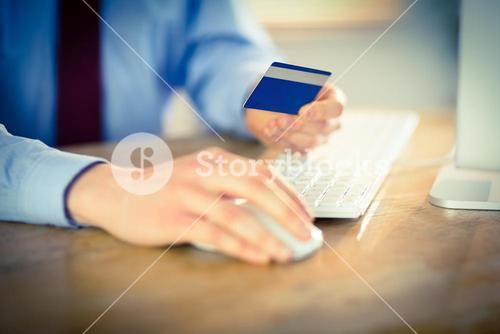Businessman shopping online at desk