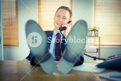 Relaxed businessman making a phone call