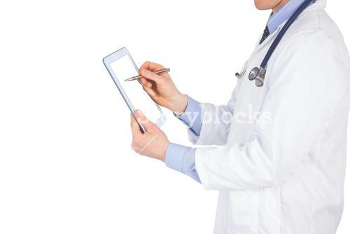 Doctor scrolling on a digital tablet