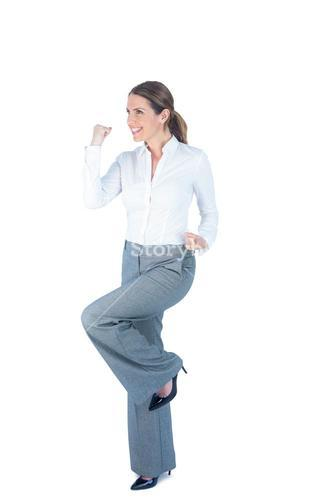 Businesswoman doing a victory pose
