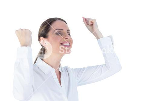Businesswoman cheering with arms up