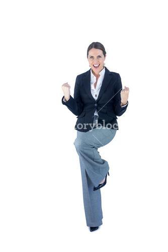 Portrait of a businesswoman doing a victory pose