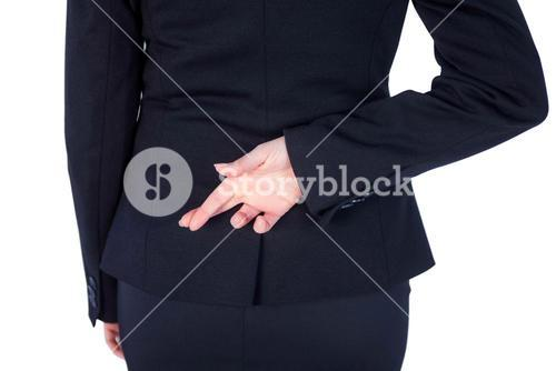 Close up pretty businesswoman with finger crossed