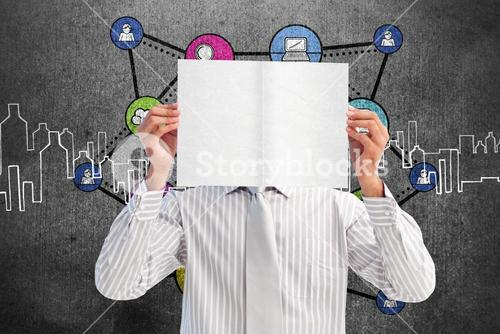 Composite image of businessman holding a white card covering his face