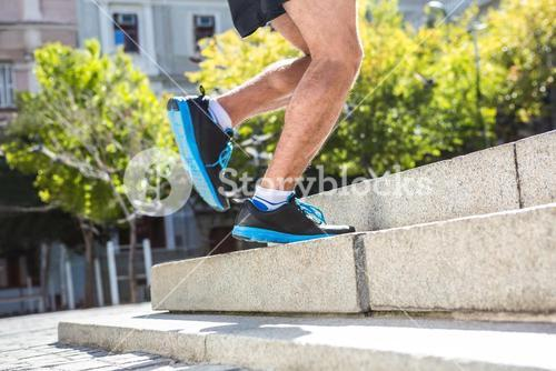 Athlete jogging up the stairs