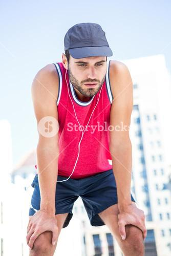 Exhausted athlete leaning forward after an effort