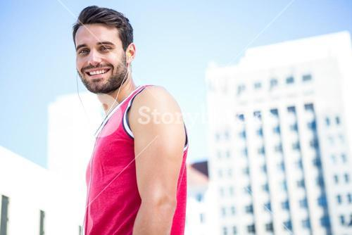 Smiling handsome athlete looking at the camera