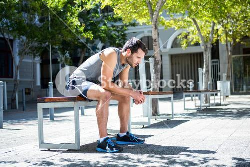 Exhausted athlete resting on a bench