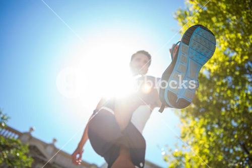 Handsome athlete running in the street